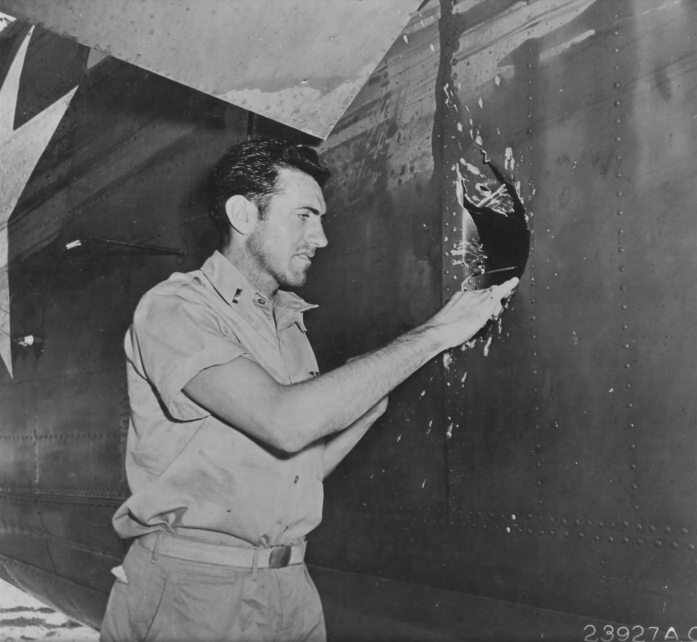 Zamperini examines a hole in his B-24D Liberator Super Man made by a 20mm shell over Nauru.
