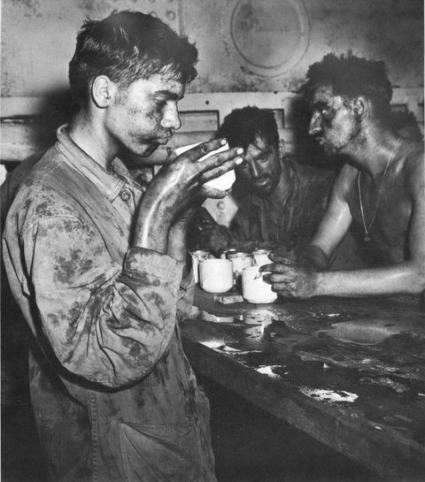 Battle-weary Marines of the 22nd Regiment drank coffee after heavy fighting on Einwetok Atoll in the Pacific Theater in February 1944.Credit National Archives and Records Administration