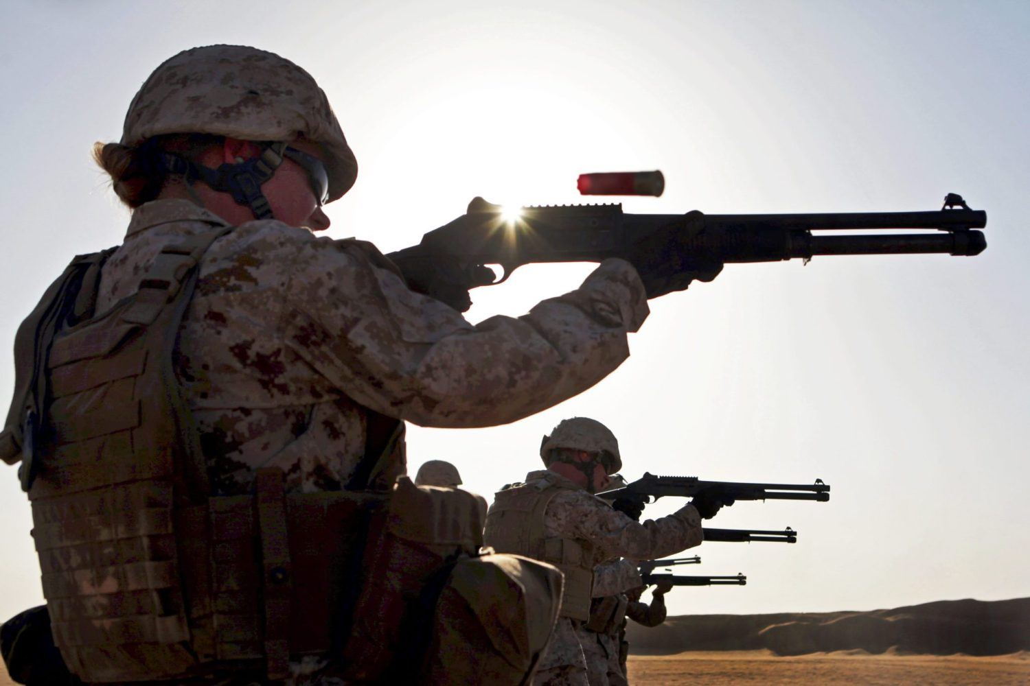 Sgt. Regina Smith, the radio supervisor and Sherevport, La., native with Combat Logistics Battalion 24, 24th Marine Expeditionary Unit, fires an M1014 shotgun during a shotgun range, Aug. 14, 2012, on Udairi Range, Kuwait. The Marines are in Kuwait as part of a 24th MEU sustainment training package. The 24th MEU is deployed with the Iwo Jima Amphibious Ready Group as a U.S. Central Command theater reserve force providing support for maritime security operations and theater security cooperation efforts in the U.S. 5th Fleet area of responsibility. (Official Marine Corps photo by Sgt. Richard Blumenstein)