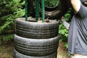 Add dirt after you place each tire, just enough so it remains stable.