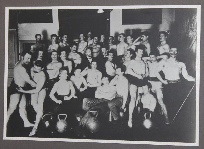 Dr. Vladislav Kraevsky and his students . Dr. V.Kraevskiy is a founder of Olympic and Kettlebell lifting in Russia, the professional training hall was open on August 10. 1885 in Saint Petersburg. (the picture is a courtesy of the Museum Of Weightlifting in Saint Petersburg, sponsored by IKSFA)