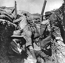 An Australian sniper aims a periscope-equipped rifle at Gallipoli in 1915. The spotter beside him is helping to find targets with his own periscope. Photo by Ernest Brooks.