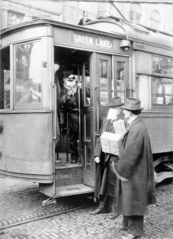 Street car conductor in Seattle not allowing passengers aboard without a mask. 1918. National Archives