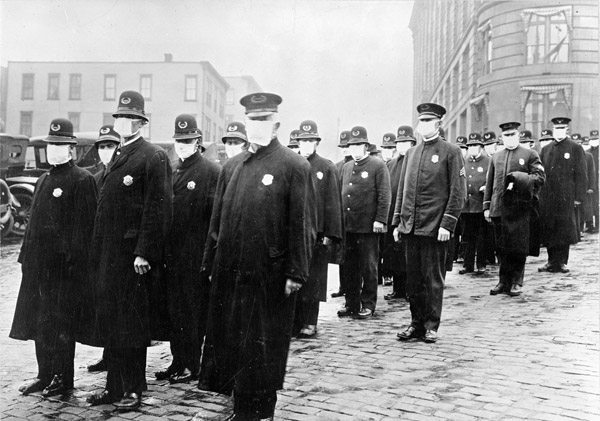Policemen in Seattle wearing masks made by the Red Cross, during the influenza epidemic. December 1918. National Archives
