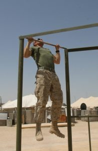 CAMP TAQADDUM, Iraq -- A rifleman with the Provisional Rifle Company, Headquarters and Service Battalion, 2d Force Service Support Group (Forward), Lance Cpl. Jacob T. Barker does pull-ups as part of his daily physical training program. The San Antonio native's job while deployed to Iraq, fighting the Global War on Terrorism, is to provide security for the service members aboard the base.