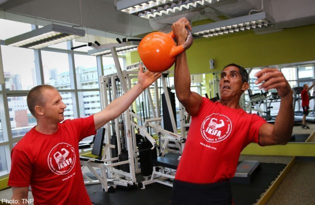 Singapore's top kettlebell lifter David Devito (right) training with his Russian coach and five-time world champion Sergey Rudnev.