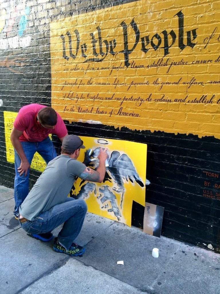 Veterans Alley, San Francisco 2015. Evan and his son putting up a Heavy Days (Banksy style) stencil piece.