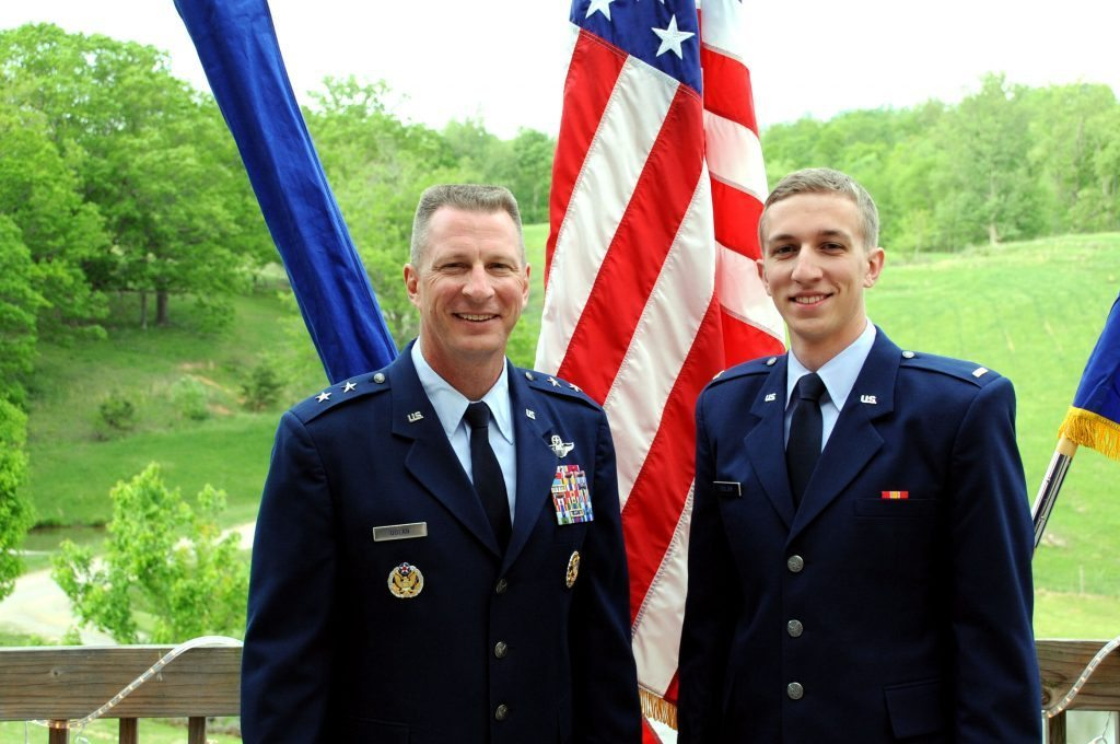 Maj. Gen. John Dolan, Assitant Deputy Commander for U.S. Air Forces Central Command and Assistance Vice Commander for the 9th Air Expeditionary Task Force, poses with his son, 2nd Lt. Joe Dolan, after a promotion ceremony in Blacksburg, Va., May 17, 2014. Lieutenant Dolan proctored his father's promotion ceremony day after his father commissioned him.