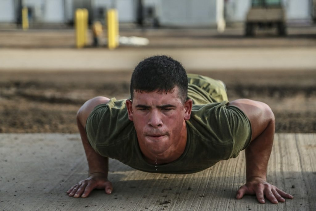 CAMP LEMONNIER, Djibouti (Sept. 11, 2015) U.S. Marine Lance Cpl. George Camden does push-ups during unit physical training. Camden is a driver with Weapons Company, Battalion Landing Team 3rd Battalion, 1st Marine Regiment, 15th Marine Expeditionary Unit. The Marines use unit PT to acclimatize to Djibouti's temperatures, and stay fit. Elements of the 15th MEU are preparing to conduct bilateral training with the 5th Overseas Combined Arms Regiment (RIAOM) in Djibouti in order to improve interoperability between the MEU and the French military. (U.S. Marine Corps photo by Sgt. Steve H. Lopez/Released)