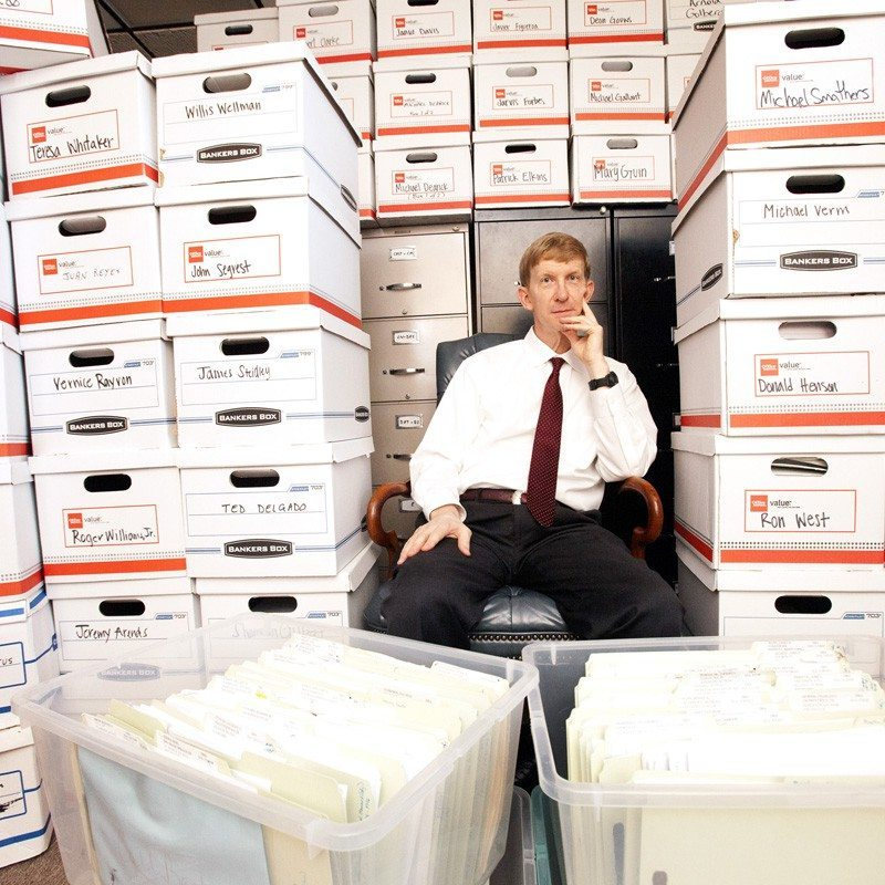 Picture of my Former attorney Gary Pitts sitting with a plethora of files in his churn and burn op courtesy of Houstonpress.com